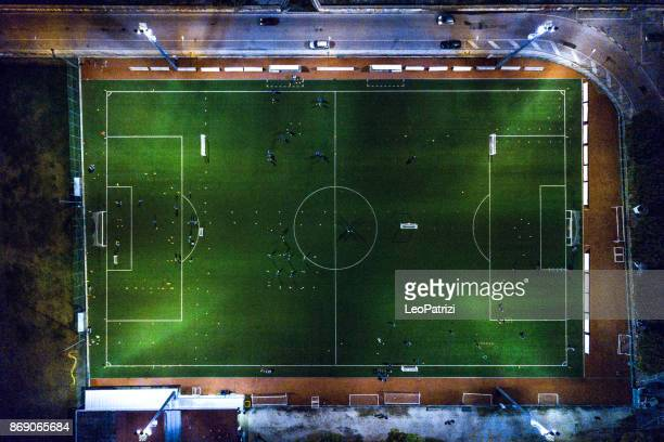 soccer field at night - aerial view - football field stock pictures, royalty-free photos & images
