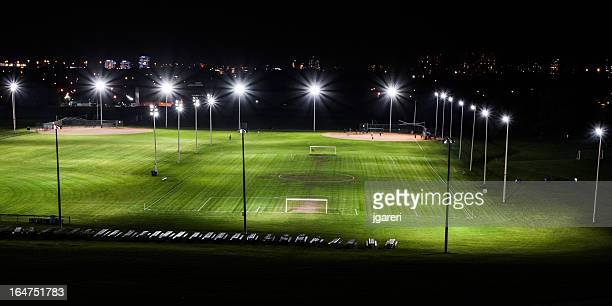 soccer field at night - floodlit stock pictures, royalty-free photos & images