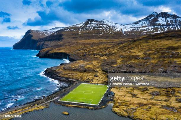 soccer field, eidi, eysturoy island, faroe islands - football pitch stock pictures, royalty-free photos & images