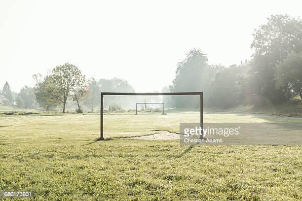 soccer field in dawn - tor konstruktion stock-fotos und bilder
