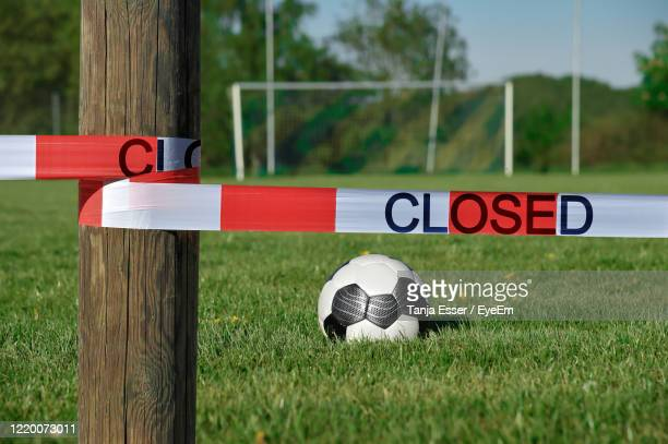 a soccer field is closed with a barrier tape. due to  corona soccer matches have been cancelled. - travel ban stock pictures, royalty-free photos & images