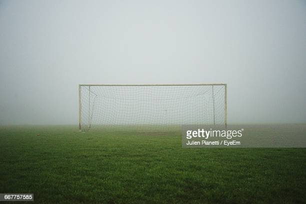 Soccer Field On Foggy Morning