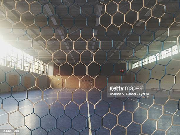 Soccer Field Seen Through Metal Grate
