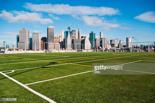 soccer fields and lower manhattan skyline, new york city, usa - manhattan new york city stock pictures, royalty-free photos & images