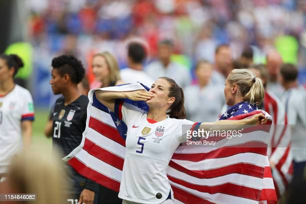 FIFA Women's World Cup Final USA Kelley O'Hara victorious holding up USA flag after winning game vs Netherlands at Parc Olympique Lyonnais...