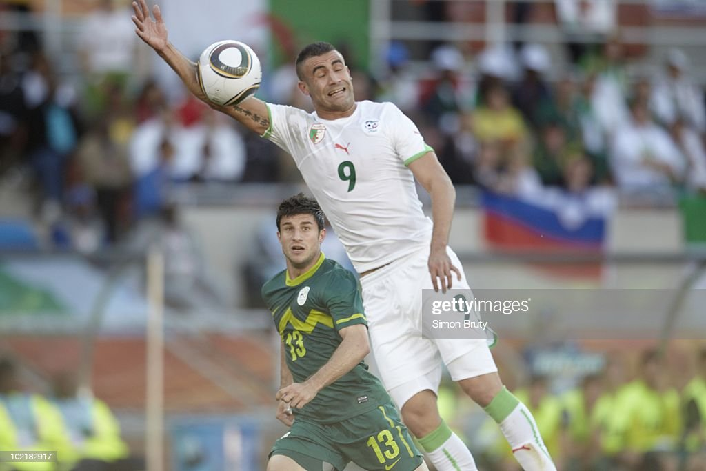 Algeria Abdelkader Ghezzal (9) in action, hand ball during 73rd minute vs Slovenia during Group C - Match 6 at Peter Mokaba Stadium. Ghezzal was issued a red card and sent off after receiving second yellow card of game for this play, Polowane, South Africa 6/13/2010