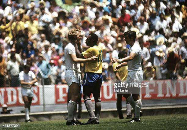 FIFA World Cup Brazil Pele speaks to England captain Bobby Moore and Alan Mullery after winning Group 3 match at Estadio Jalisco Guadalajara Mexico...