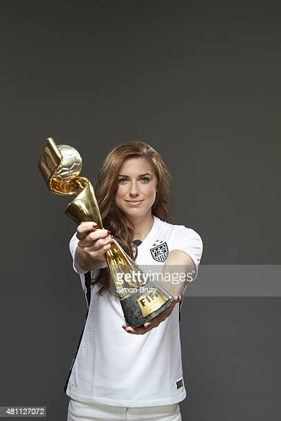 FIFA World Cup Champions Portrait of US Women's National Team forward Alex Morgan holding trophy during photo shoot at ABC News' Good Morning America...