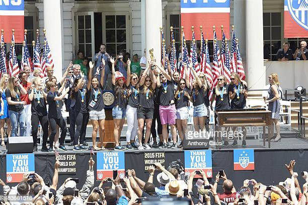 FIFA World Cup Championship Ceremony Abby Wambach and teammates victorious on stage with medals during Victory Ceremony at City Hall New York NY...