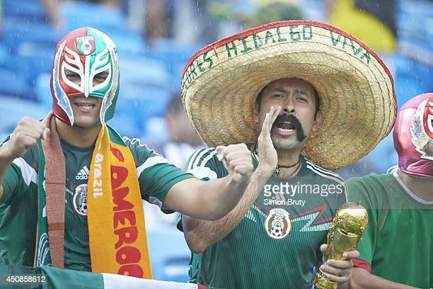 FIFA World Cup Closeup of Mexico fans wearing luchador masks and sombrero hats in stands during Group Stage Group Amatch vs Cameroon at Estadio das...