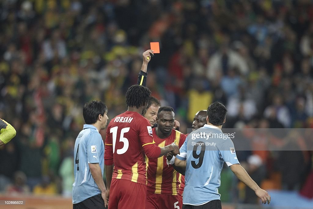 FIFA referee Olegario Benquerenca issuing red card and sending off Uruguay Luis Suarez (9) after intentional handball vs Ghana during Match 58 - Quarterfinals at Soccer City Stadium. Johannesburg, South Africa 7/2/2010