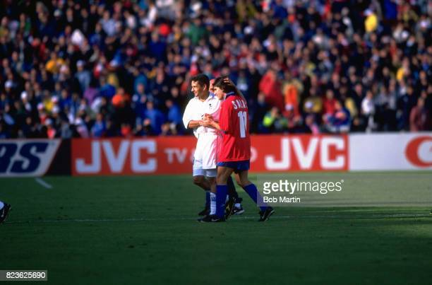 FIFA World Cup Italy Roberto Baggio shaking hands with Chile Marcelo Salas on field after game at Parc Lescure Bordeaux France 6/11/1998 CREDIT Bob...