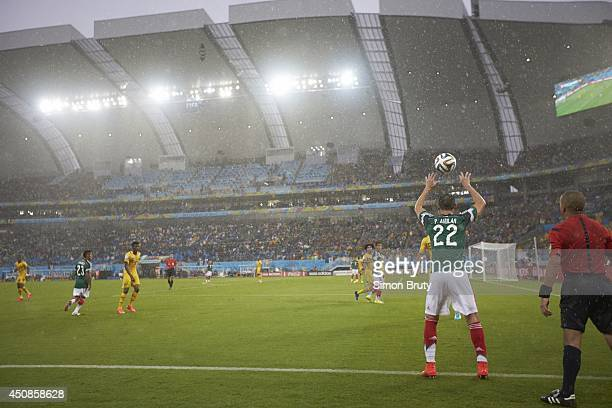 World Cup: Mexico Paul Aguilar in action, throw in vs Cameroon during Group Stage - Group Amatch at Estadio das Dunas. Rain, weather. Natal, Brazil...