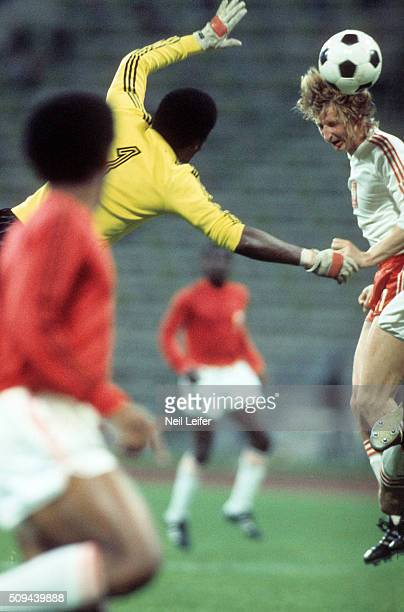 FIFA World Cup Poland Leslaw Cmikiewicz in action head ball vs Haiti goalie Henri Francillon during Group Stage Group 4 game at Olympiastadion Munich...