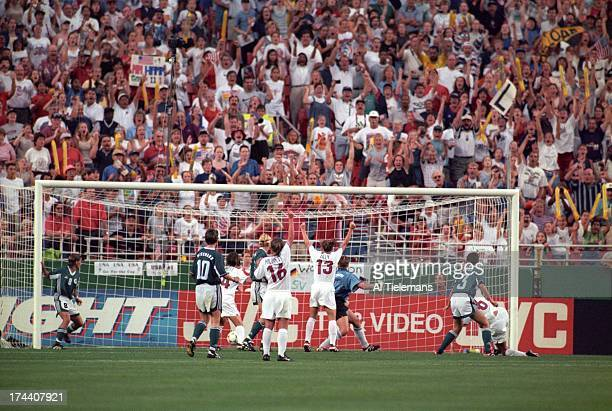 FIFA World Cup USA Brandi Chastain victorious with Kristine Lilly and Tiffeny Milbrett after scoring game tying goal vs Germany during Quarterfinals...