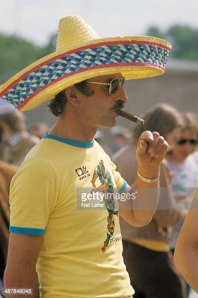 World Cup: View of Chile fan wearing hat and smoking cigar before First Round - Group 1 game vs West Germany at Olympiastadion. Berlin, West Germany...