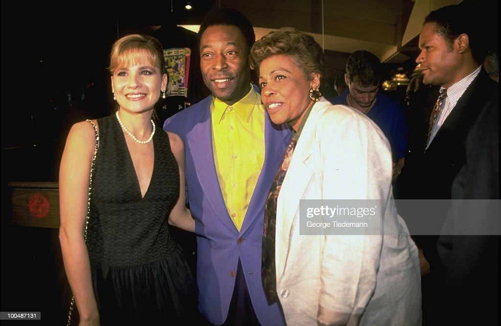 Former player Pele posing for photo with wife Assiria Seixas Lemos during media event. New York, NY 5/12/1994