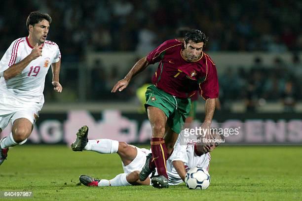 Soccer Friendly game, Portugal vs Spain. Figo battling with Tristan and Xavi of the Spanish team. Match de football amical, Portugal contre Espagne....