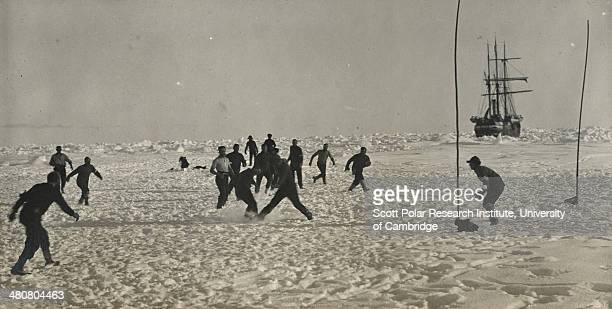 A soccer game during a 'holdup' in the Imperial TransAntarctic Expedition 191417 led by Ernest Shackleton The 'Endurance' is in the background