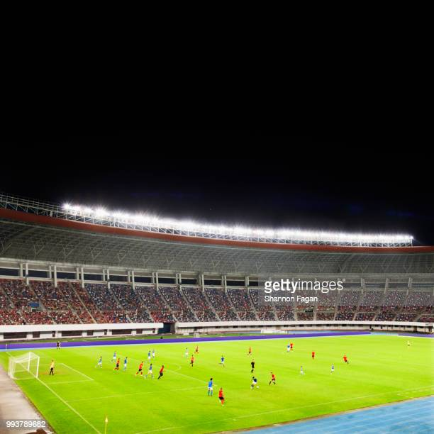 Soccer game in a stadium at night
