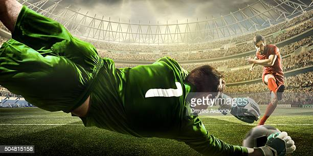 soccer game moment with goalkeeper - shootout stock pictures, royalty-free photos & images