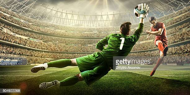 soccer game moment with goalkeeper - soccer stock pictures, royalty-free photos & images