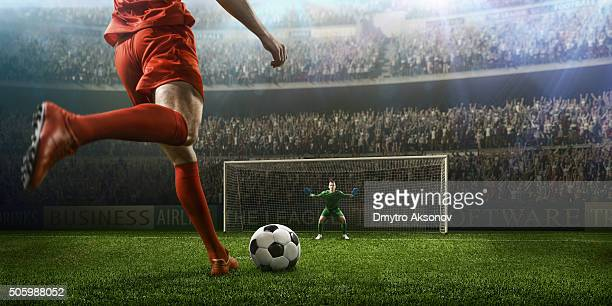 soccer game moment with goalkeeper - kicking stock pictures, royalty-free photos & images
