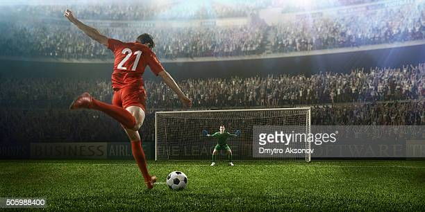 soccer game moment with goalkeeper - football stock pictures, royalty-free photos & images