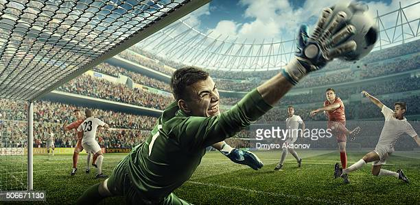 soccer game moment with goalkeeper - goalkeeper stock pictures, royalty-free photos & images