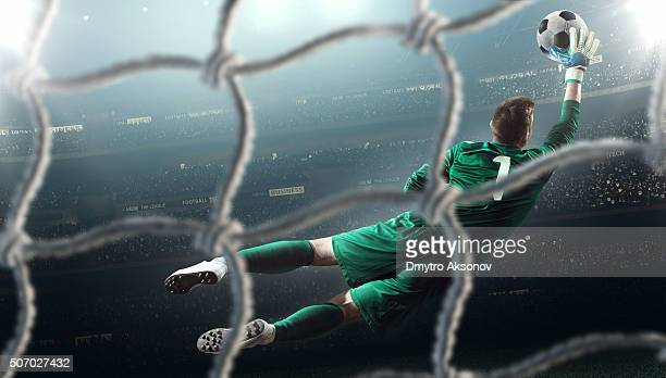soccer game moment with goalkeeper - goalie goalkeeper football soccer keeper stock pictures, royalty-free photos & images