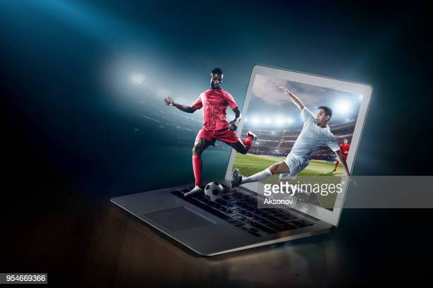soccer game on laptop. live broadcast - face off sports play stock photos and pictures