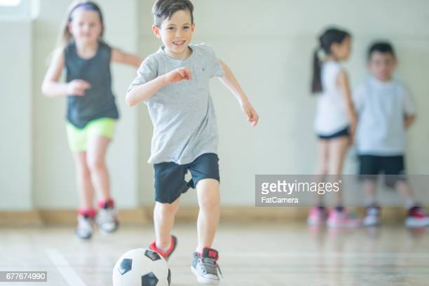 soccer game - physical education stock pictures, royalty-free photos & images