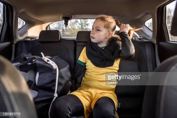 soccer girl driving to football training alone - sportswear stock pictures, royalty-free photos & images