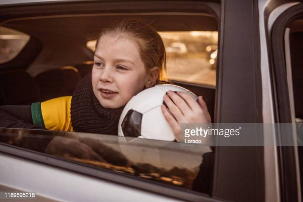 soccer girl driving to football training - drive ball sports stock pictures, royalty-free photos & images