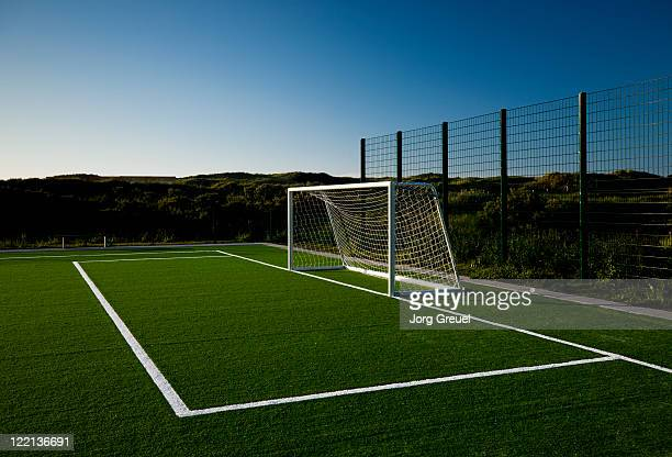 soccer goal at sunset - football pitch stock pictures, royalty-free photos & images