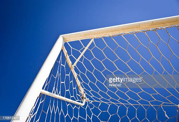 soccer goal net against blue sky - goal post stock photos and pictures