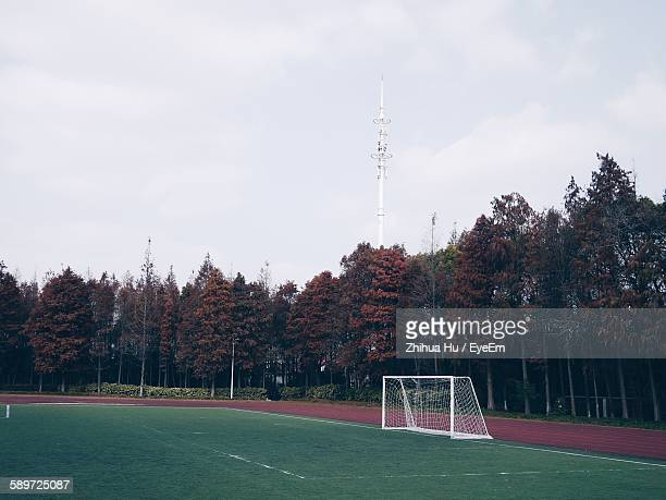 Soccer Goal On Field By Trees Against Clear Sky