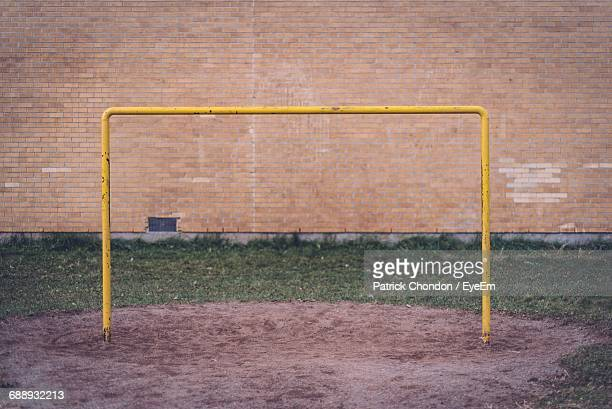 soccer goal post against wall on field - soccer goal stock pictures, royalty-free photos & images