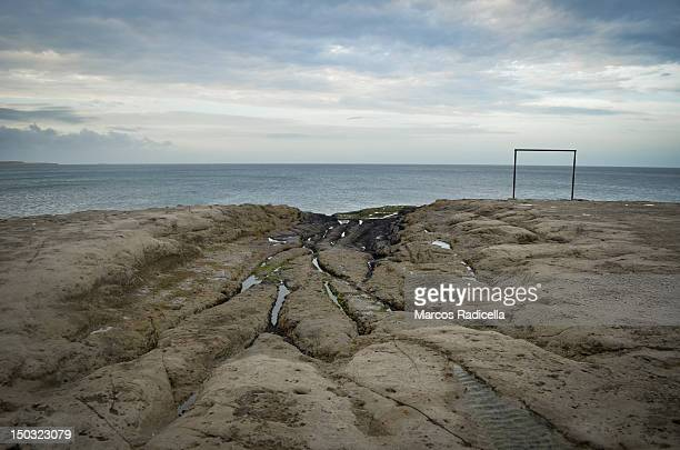 Soccer goal post by ocean shore Argentina