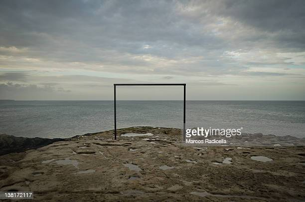 soccer goal post by ocean shore - radicella photos et images de collection