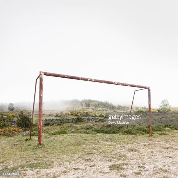 soccer goal post on rural field - soccer goal stock pictures, royalty-free photos & images