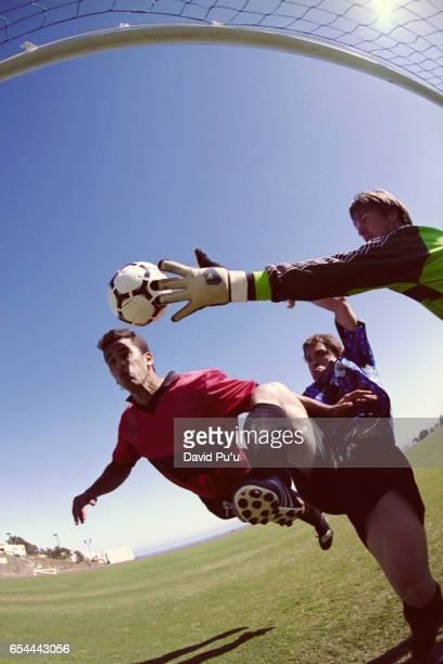 Soccer Goalie Attempting to Block Shot