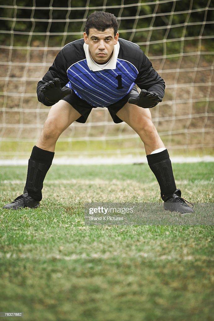 Soccer goalie defending goal : Stock Photo