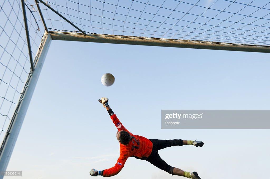 Soccer goalie defending in mid-air : Stock Photo