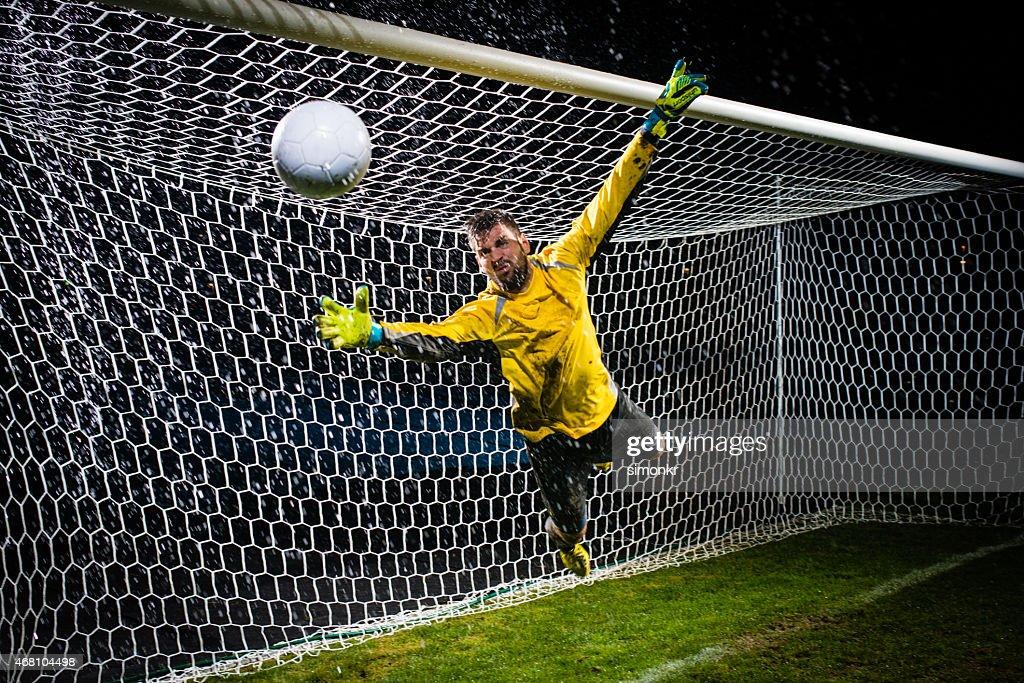 Soccer Goalie Jumping For Ball : Stock Photo