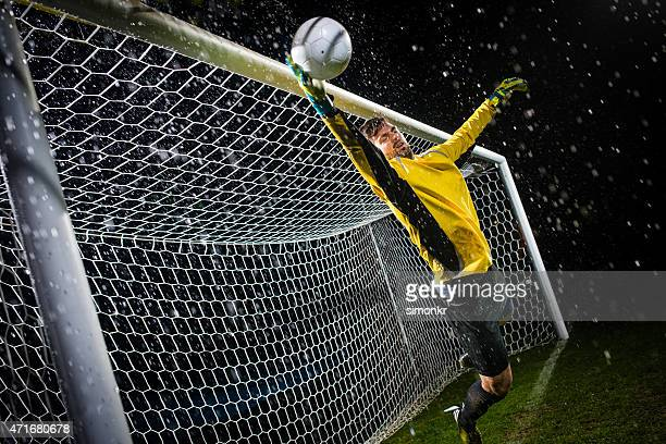 soccer goalie jumping for ball - goalie goalkeeper football soccer keeper stock pictures, royalty-free photos & images