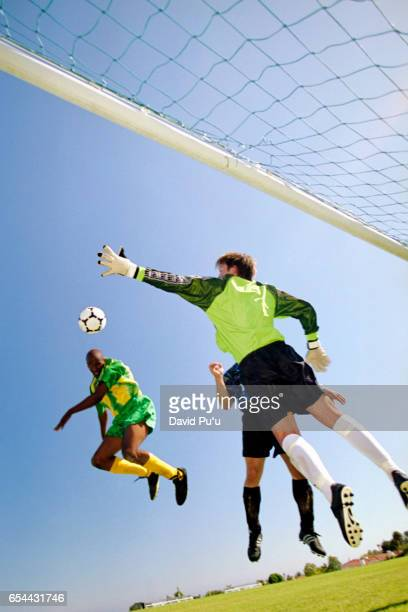 Soccer Goalie Leaping to Catch Ball