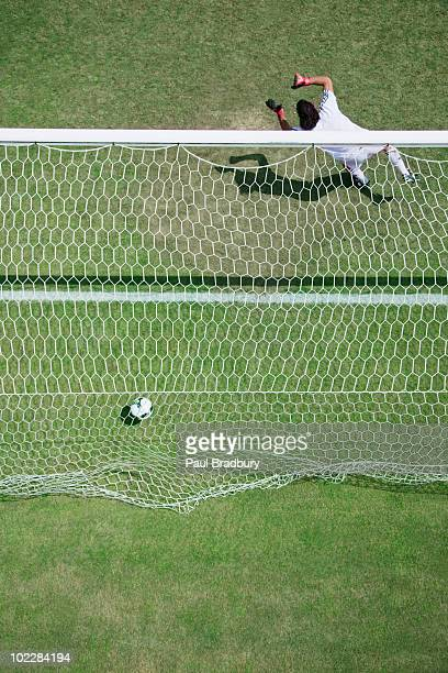 soccer goalie missing soccer ball - scoring a goal stock pictures, royalty-free photos & images