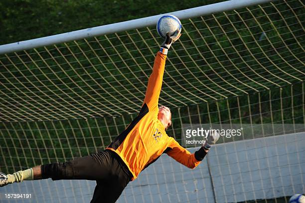 soccer goalie - making a save stock photos and pictures