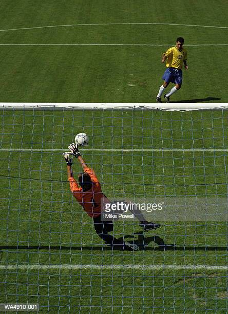 soccer goalie reaching for ball - diving to the ground stock pictures, royalty-free photos & images